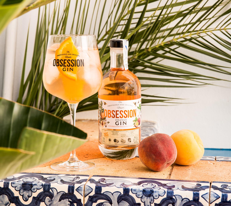 Andalusí Beverages reinventa su ginebra Obsession Orange con base de melocotón y fruta de la pasión